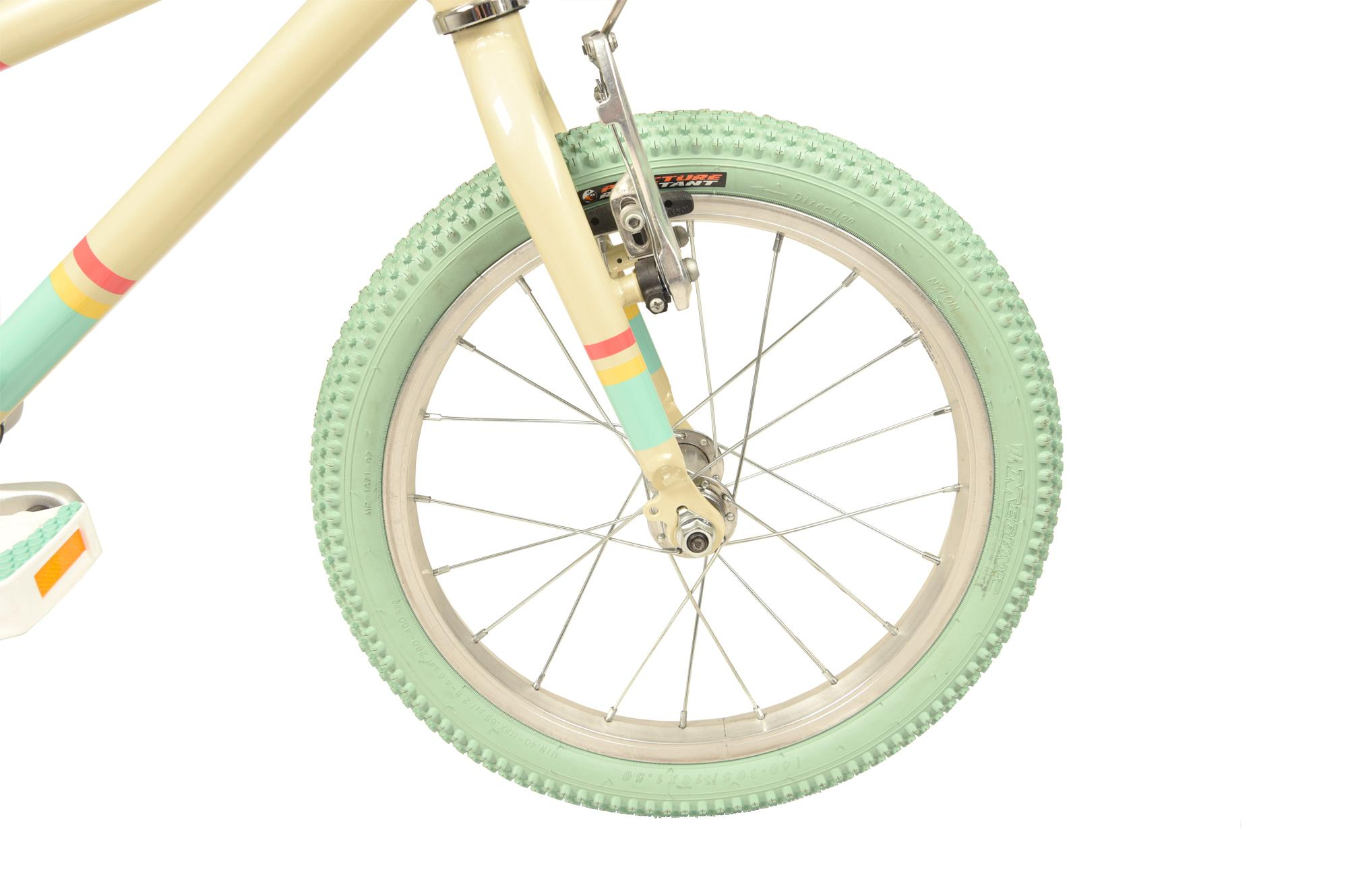 Front wheel on the Raleigh Pop 16 inch kids bike in cream colour