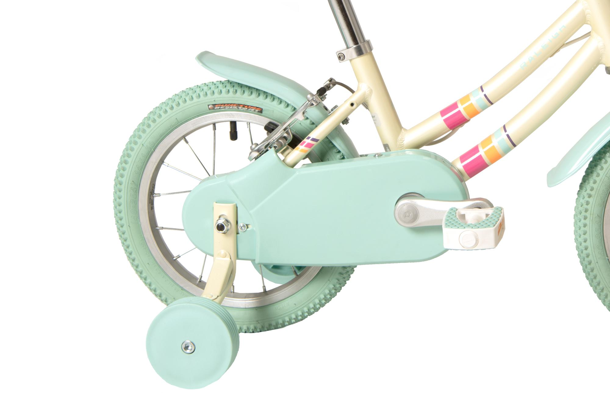 Chain guards and stabilisers on the Raleigh Pop 14 inch kids bike for girls in colour white