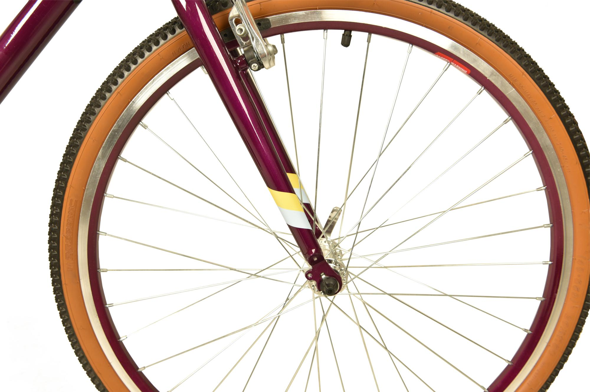 Front wheel on the Raleigh Pop 26 inch kids bike in colour purple