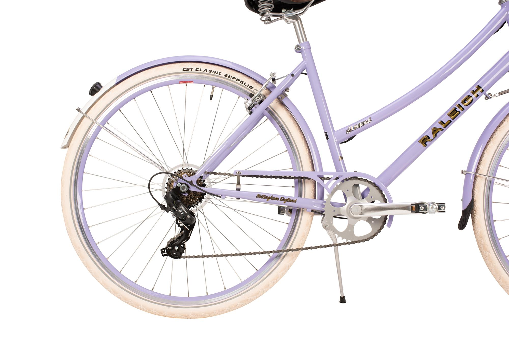 Rear wheel on the Raleigh Sherwood classic ladies bike in lilac colour