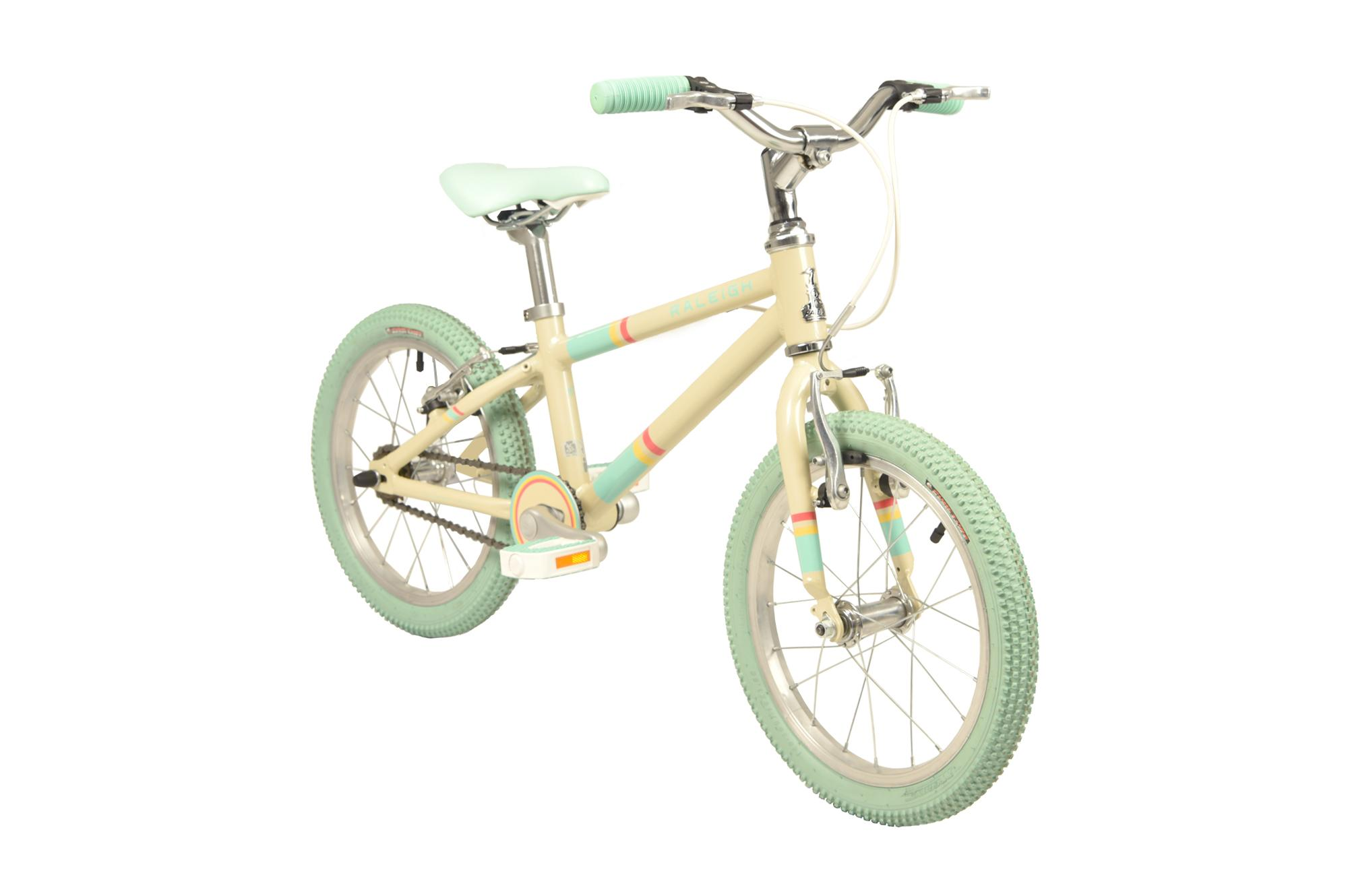 Front view of the Raleigh Pop 16 inch bike in cream colour