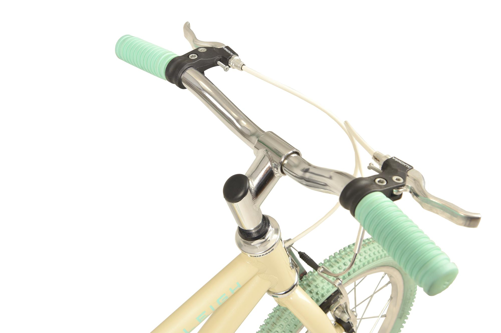 Handlebars on the Raleigh Pop 16 inch kids bike in colour cream