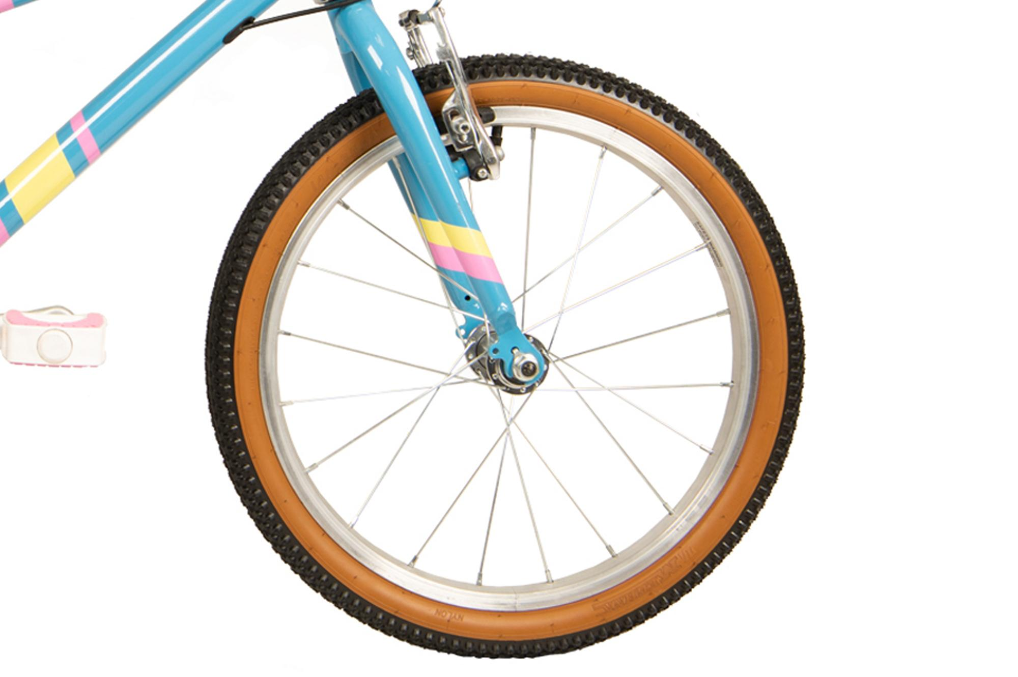 Front wheel on the Raleigh Pop 18 inch kids bike in light blue
