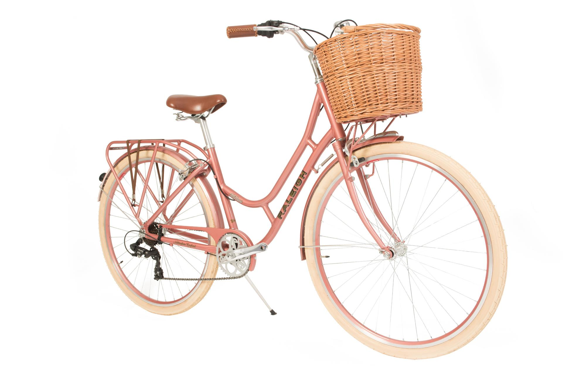 Front side view of the Raleigh Willow classic ladies bike with basket in pink